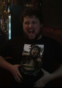 Drunk girl at the bar asked my friend if the picture on his shirt was him as a kid