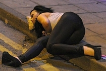 Drunk girl using pizza slice as a pillow