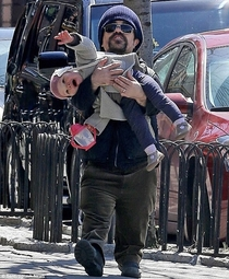 feeling sad Here is a picture of Peter Dinklage holding his baby