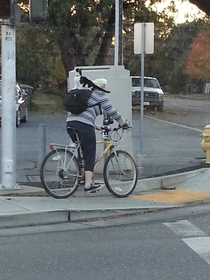 Finally saw something reddit worthy today after years of lurking sorry for the poor quality Thats a cat riding a person who is riding a bike
