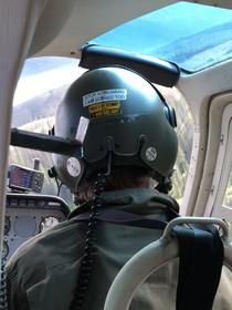 Flew in a helicopter for the first time at work the pilots helmet wasnt calming