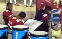 Football players playing hangman during a game