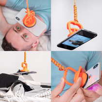 For fun I design fake products that solve problems in an unnecessary way The iDangle is the hands free way to watch your phone inches from your face in bed