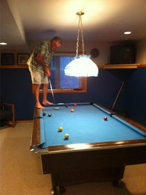 Found my dad playing pool like this