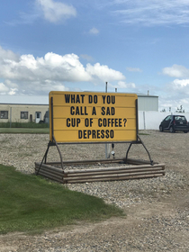 Funny coffee shop sign on the side of the highway in Saskatchewan