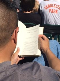 Guy in front of me seems to have gotten his hands on the Cowboys play book
