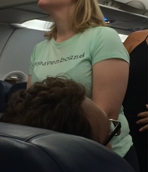 Her shirt says Heavenbound Literally one of the last shirts you want to see on your flight