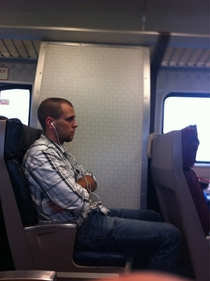Hes been listening to Miley Cyrus for the past min not realizing that its so loud that the train car can hear it too