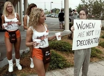 Hooters girls bringing an upset woman something to drink