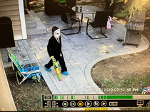 Husband just sent me this picture of our  year old sonHalloween fanatic from our backyard camera Basically a mix between Alex P Keaton and Jason Getting ready to terrorize all the neighborhood kids