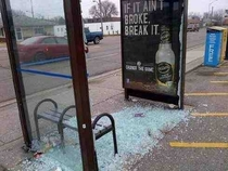 I blame the advertisement for what happened to this bus shelter