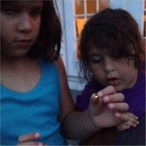 I couldnt help but think that this picture of  young kids catching a firefly looks like them passing a joint