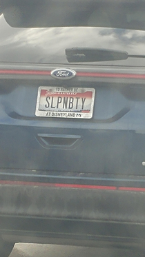 I first read this as slappin booty then I noticed the license plate frame
