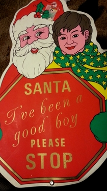 I found this sign at a friends house mildly disturbing Santa