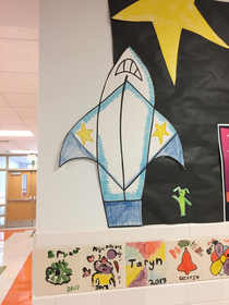 I was at my daughters school today I asked her why there was a shark ripping off its shirtmom thats a rocket ship