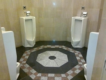 If four men pee at the same time in these urinals a path to a secret boss will open