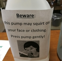Ill advised but hilarious warning sign on the hand sanitizer dispenser at work