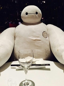 In Shanghai if you go to dinner alone they put this character at the table to keep you company