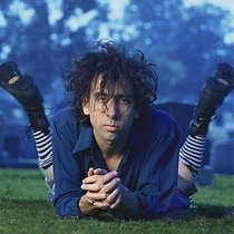 In This Photo Tim Burton looks like a cracked out Nicholas Cage