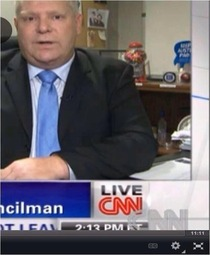 Is that a bottle of vodka under Doug Fords desk during an interviewcouncil member of toronto and brother to Rob Ford
