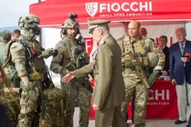 Italian Army General Claudio Graziano trying to shake hands with a military dummy during an official event