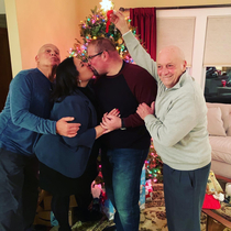 Its our first married Christmas and we were trying to take a cute photo by the tree My dad and great uncle just doing their jobs