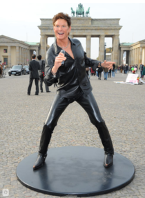 Its the  anniversary of the Fall of the Berlin Wall in Germany and to help celebrate they placed a life sized wax statue of the Hoff in front of the Brandenburg Gate