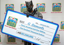 Jamaican lotto winner dresses as The Black Panther to hide his Identity RIP Chadwick Boseman