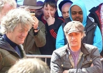 James May and Richard Hammond in front of a lively crowd