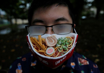 Japanese artist creates ramen face mask to complement fogged glasses via Reuters TW