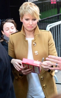 Jennifer Lawrence autographing a box of Cheeze-Its