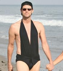 Just a Picture of Jim Carrey Staring Down a Paparazzi Photographer in His Girlfriends  Piece Bathing Suit