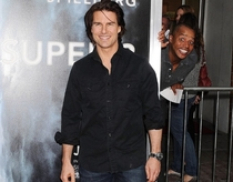 Just Donald Faison from Scrubs photobombing Tom Cruise