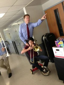 Just me and my professor riding a tricycle while I play the trombone
