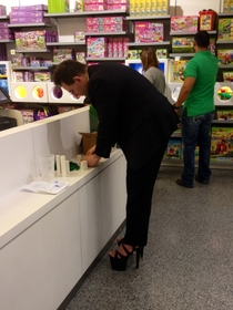 Just your average businessman wearing hooker heels in the Lego store