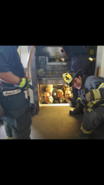 Kansas City fire department saves Kansas City police department from elevator