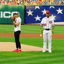 Katie Ledecky had Bryce Harper hold all of her medals while she threw out the first pitch