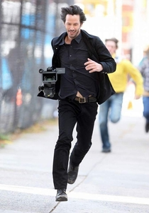 Keanu Reeves after stealing a camera from the paparazzi