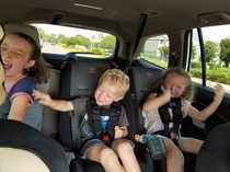 Kids first time hearing Bohemian Rhapsody air guitars abound