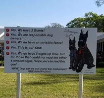 Large sign facing main road homeowner installed after recieving complaints about their dogs