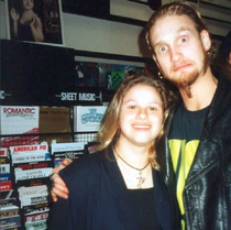 Layne Staley of the grunge band Alice in Chains with a fan in a record store in the s