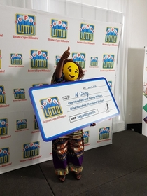 Lottery winner shows up in an emoji mask - its perfect