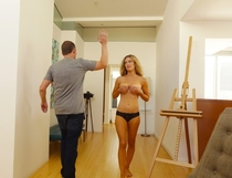 Man requesting high-five from model