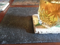Mother-in-law scolded me for putting my cup on the stone part of her table So she hands me a Stone coaster
