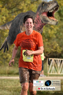 My aunt posted a picture of her crossing the finish line in a marathon so my dad photoshopped a T-Rex in behind her