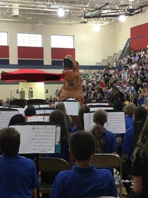 My band director wore a T-Rex suit At a concert during a performance While conducting in it