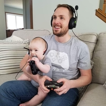 My best bud and his -month-old son playing video games together Sort of
