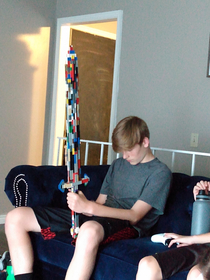 My brother built a Lego sword now hes playing on his phone What a legend
