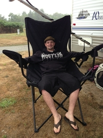 My brother sitting in my new camping chair hes