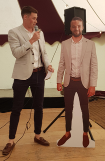 My brothers best friend is driving to Mongolia for charity so they brought a cardboard cutout of him to the wedding reception